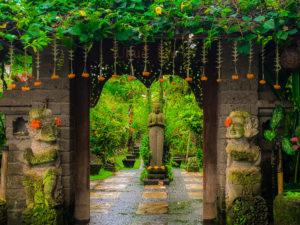 ubud bali orange flowers and statues